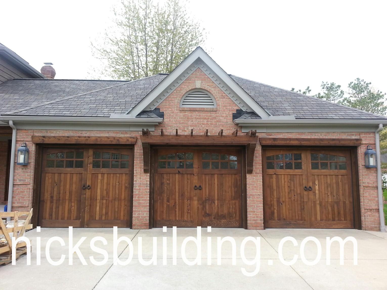 Wood overhead garage doors and carriage garage doors for for Hardwood doors for sale